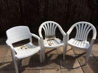 3 White plastic garden chairs