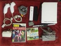 WII CONSOLE WITH CONTROLLERS , NUNCHUCKS AND GAMES