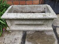 A used reconstituted granite flower pot