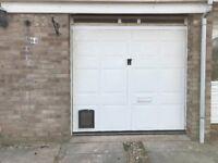 Free Garage Door. In working order and very good condition.