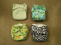 Four pre-loved reusable cloth nappies