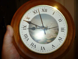 VERY OLD SPITFIRE CLOCK WITH POT BACKING PICTURE