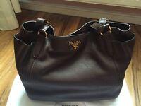 Prada leather handbag with dustbag and receipt