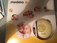 Medella electric breast pump plus accessories