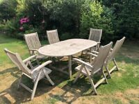 Wooden Patio Table and 6 Reclining wooden chairs