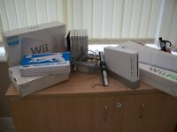 Nintendo console and Wii fit plus accessories
