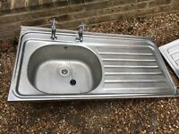 Two stainless steel kitchen sinks