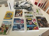 Nintendo wii with wii fit board, controller and games