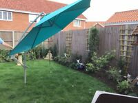 A large catalever garden umbrella. As new.
