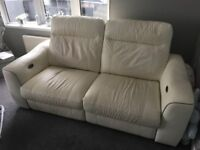 leather electric recliner sofa with arm chair to match and rings coffee table in mint condition!!