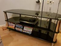 Black glass and silver 3 tier tv stand.