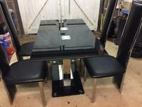 Table and chairs chrome and black dinning room