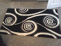 Black, cream and grey rug