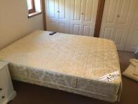 Adjustable king size bed with therapeutic massage feature