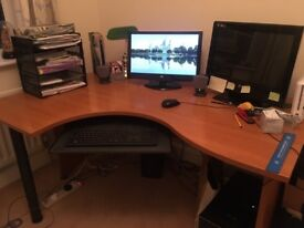 Kidney shaped computer/office deskLength 160cm width 110cm/80cm, height 74cm. Collect only. £200.00