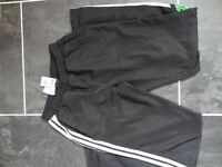 Boys ADIDAS black shell joggers with white stripe Age 15-16 yrs