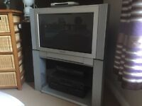 "Panasonic 26"" wide screen TV with stand with glass shelves."