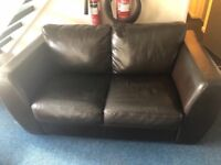 Brown 2 seater leather look sofa