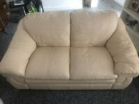 2 seater Leather Sofa (Cream Colour) With Cat damage but usable and Free ! Buyer Collects please