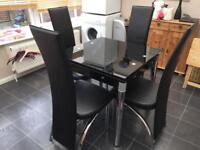 Extendable glass dining table & 4 chairs