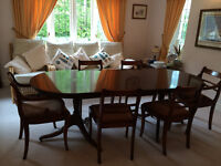 Mahogany extending dining table with 4 chairs and 2 carver chairs.
