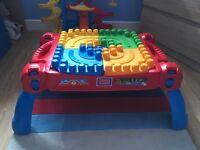 The Mega Bloks 3-in-1 Build 'N Learn Table & Box Of Mega Bloks