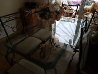 Glass and iron table and chairs
