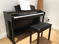 Yamaha Clavinova CLP150 electric piano in excellent condition - suit beginner or expert - with stool