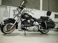 Heritage Softail, stage one with Vance Hines true duels and fishtails in Gleaming Black