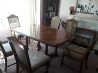 Hard wood dining table, 6 chairs and tall dresser