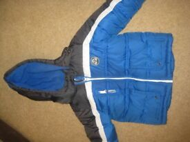 Boy's coat with a hood.