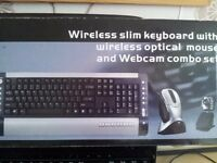 wireless keyboard, mouse, and webcam combo, ' NEW ', box has been opened to check contents.