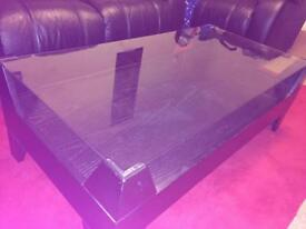 Black wood and glass top coffee table