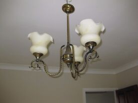 Ceiling light with 3 glass shades; antique brass colour.