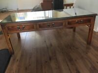 Solid wood coffee table with glass on the top