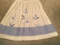 """Mainly white curtains with sequinned blue details. 28"""" x 48"""" drop (each pregathered curtain)"""