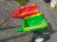 Two plastic children's car or tractor trailers sold together - red and yellow and green and yellow
