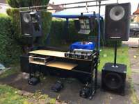 Full Mobile DJ setup. Sound system, lights, stand, trailer.