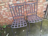 free pair of metal chairs