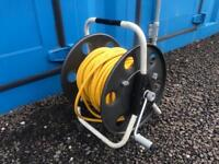Window cleaning hose reel for waterfed pole