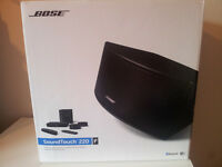 Brand new, unopened Bose SoundTuch 220 home cinema system for sale !