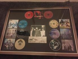 Oasis signed and professionally framed collectors item