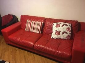 Free red 3 seater dfs sofa.