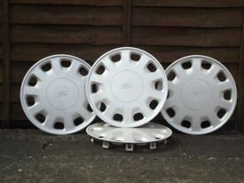 Ford wheel trims set of four, 40cm cream. Very good condition
