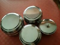 SET OF FOUR SMALL STAINLESS-STEEL FOOD CONTAINERS