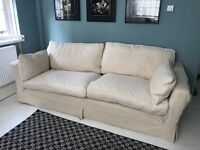 Huge sofa with feather cushions