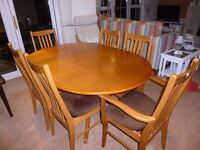Solid Teak Dining Table and 6 matching chairs