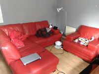 Red corner sofa (6 seaters) + chair