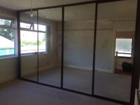 Fitted mirrored wardrobes
