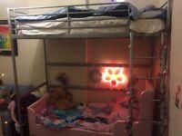 Pink Ikea Children's bed and mattress.